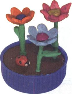 Посадите цветы в клумбу